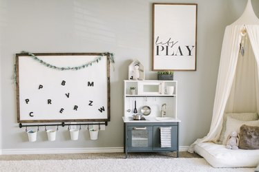 Playroom Organization Ideas with magnetic board and rail bucket system
