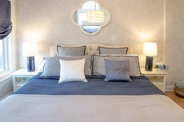 blue and white bedding featuring throw pillows