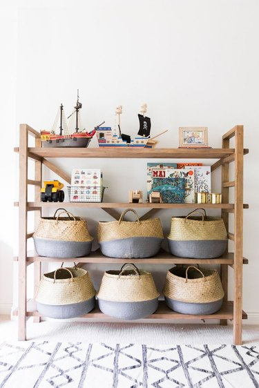 Playroom Organization Ideas with shelving unit filled with baskets