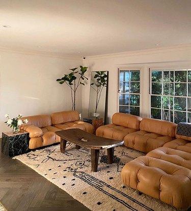 Aimee Song living room featuring brown Mario Bellini Camaleonda