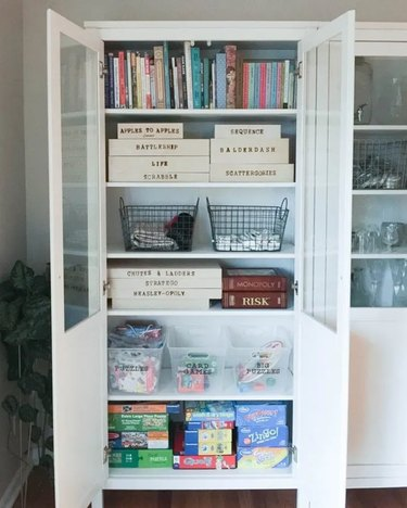 white bookcase for board game storage on the shelves