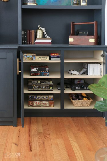 family room media center with drawers for board game storage