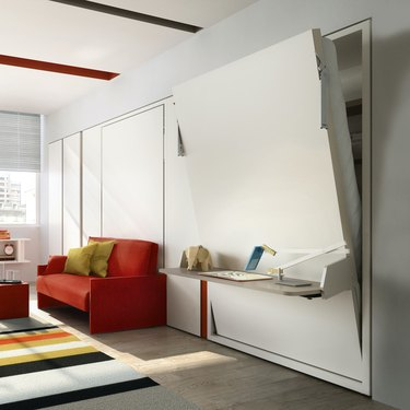 room with red couch and moving wall