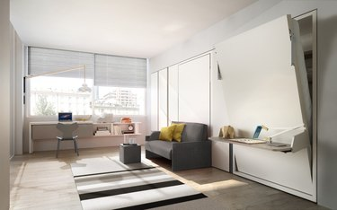 room with desk, sofa, and movable wall