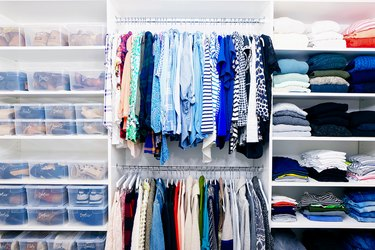 organized closet with lidded shoe storage on the side