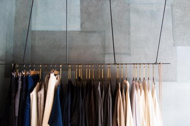 How to Organize Clothes with hanging clothes rail with organized clothes