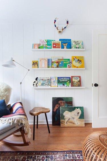 kids' book storage idea on white walls