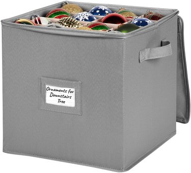 Gray ornament storage container with handles and label