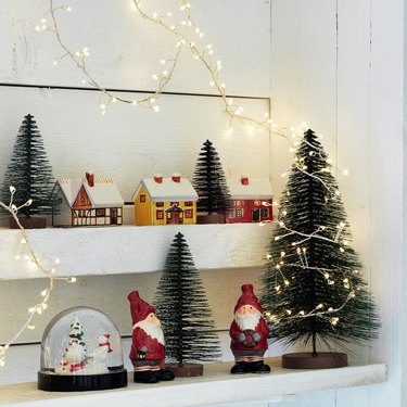 shelves with christmas trees and decorations