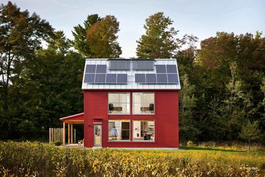red eco-friendly modular home with solar panels