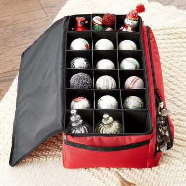 Red ornament storage container with dividers and round ornaments