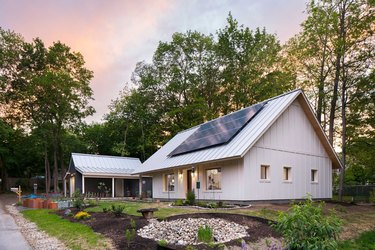 White eco-friendly modular home with solar panels