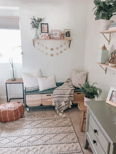 DIY storage bench with wooden bins and teal exterior in white, boho living room