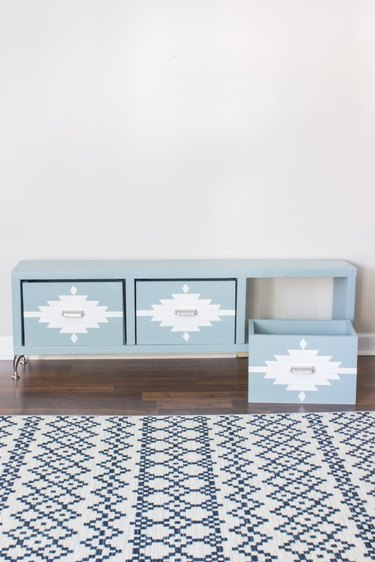 DIY storage bench in light blue with geometric detailing