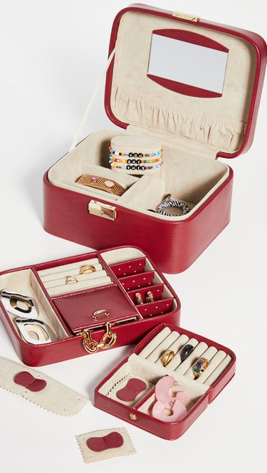 red jewelry organizer with inlays and jewelry inside