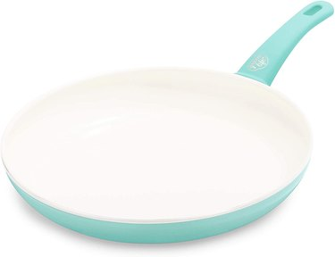Turquoise frying pan with white interior