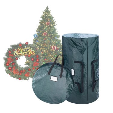 Christmas tree storage bag and wreath storage bag in green next to decorations