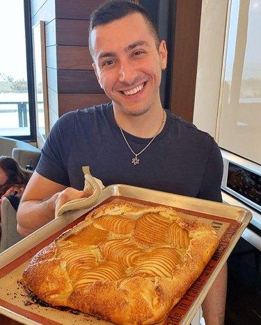 jake cohen holding a pear & vanilla frangipane galette