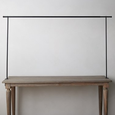 table with black rod