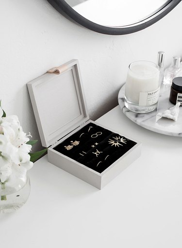 white jewelry organizer idea with black velvet interior