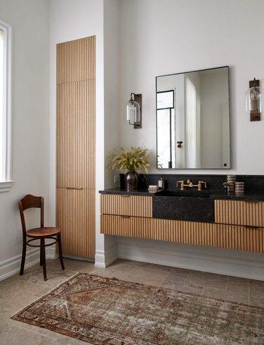 Bathroom closet organization by Amber Interiors
