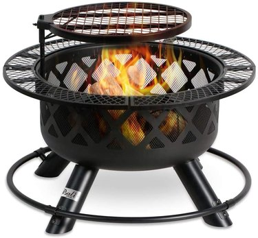 black fire pit with cooking grill