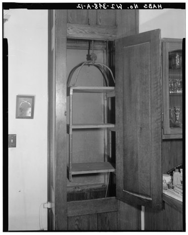 a first floor built-in dumbwaiter featuring three shelves