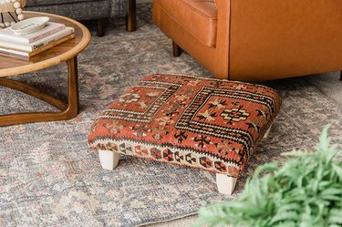 Learn how to make your own ottoman using a vintage rug.