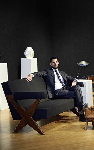 Jason Stein, Director of Modern Decorative Art + Design at Bonhams Los Angeles sitting on a couch
