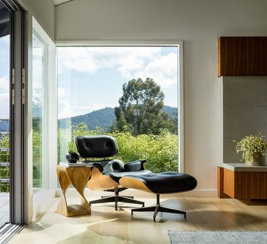 An Eames Lounge Chair provides a comfortable place to sit behind sprawling views of the Northern California landscape.