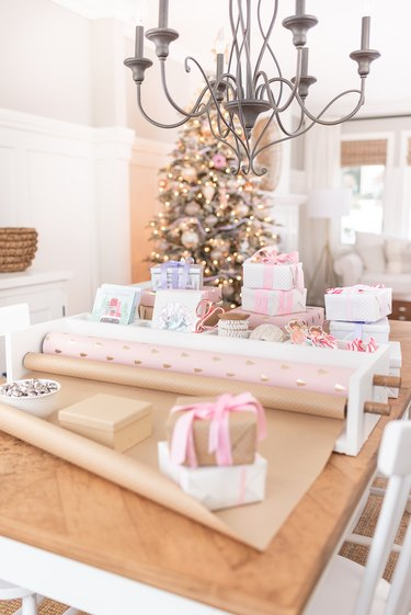 diy wrapping paper storage on wooden table