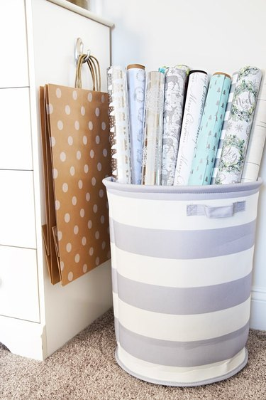wrapping paper in striped laundry hamper