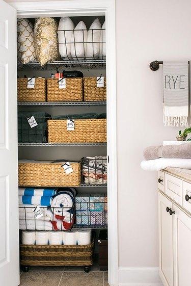 bathroom closet organization with baskets