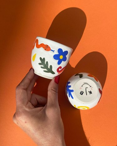 Contemporary Ceramics coffee cups with bright colorful illustrations