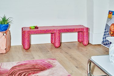 pink bench in living room area