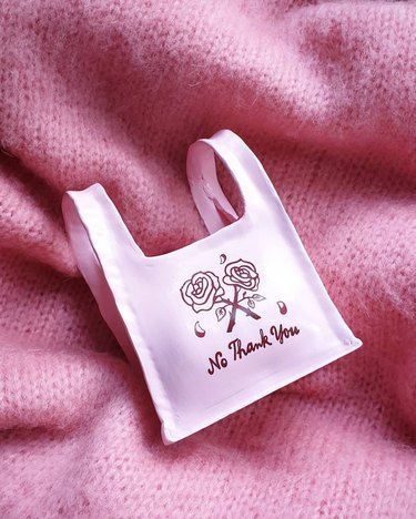 Contemporary Ceramics pink air clay bag with rose illustration