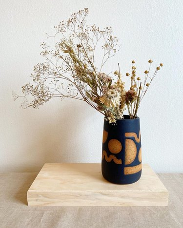 black contemporary ceramics vase with shapes in brown