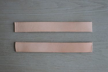 Two leather strips cut to 8 inches long