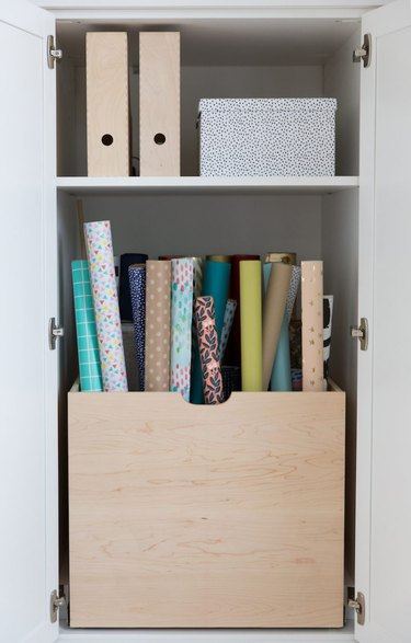 craft closet with wooden box for wrapping paper storage