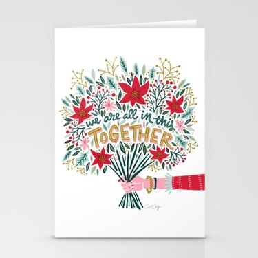 """card with bouquet that reads """"we are all in this together"""""""