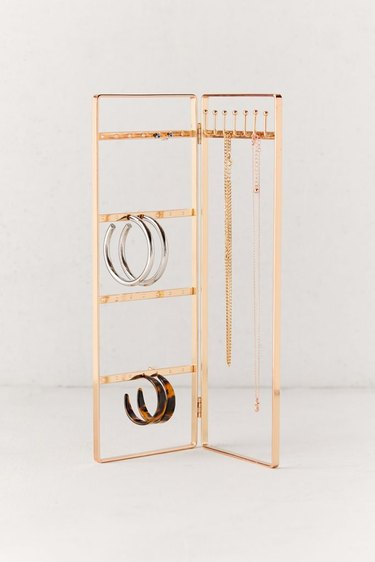Earring Storage with Brass folding jewelry organizer with hoops and necklaces.