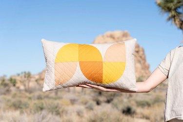 orange and yellow lumbar pillow
