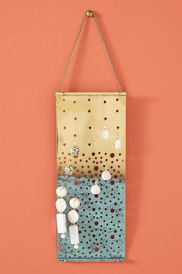 Earring Storage with Gold and turquoise hanging earring organizer with earrings.