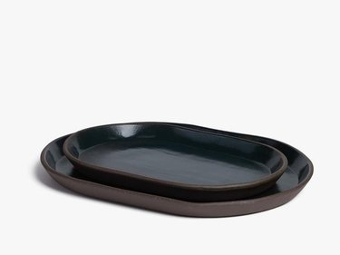 brown and navy oval ceramic platters