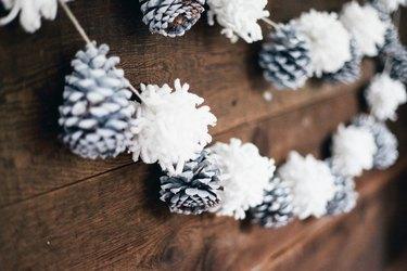 pine cone and pompom christmas garland decoration