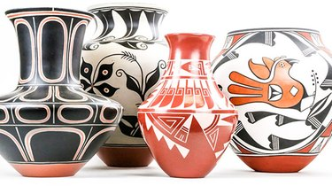 four vases in various colors