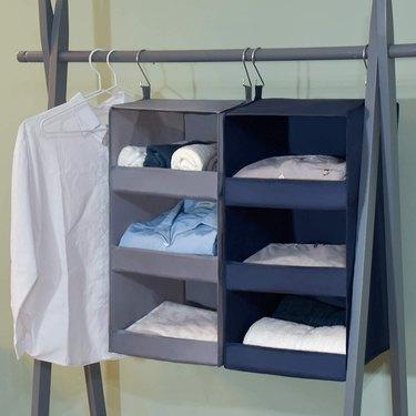 Hanging closet organizers, white shirt, hangers.