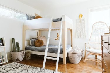 Kid's Room Organization Guide in kids bedroom with bunk bed and storage baskets