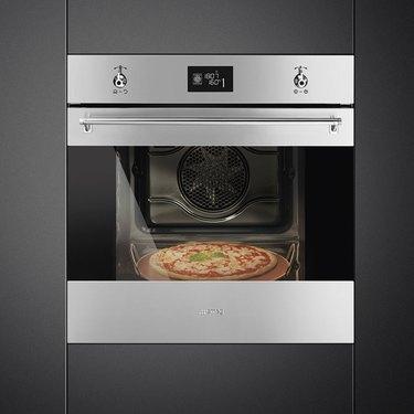 Stainless steel wall oven in black cabinets. Small Stove and Oven