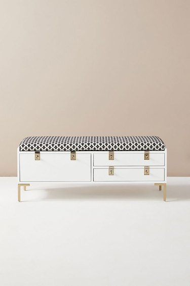 white and black bedroom storage bench with cushioned top